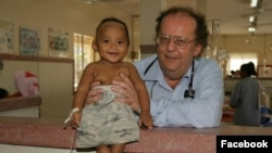 Dr. Beat Richner holds a baby at Kantha Bopha children hospital, in Phnom Penh, Cambodia. (Courtesy photo)