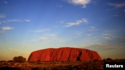 FILE: Uluru is lit by the setting sun in the Northern Territory in central Australia, April 21, 2014.