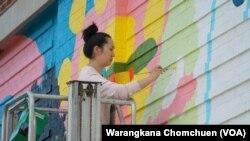 Amanda Phingbodhipakkiya, a multidisiciplinary artist and speaker based in Brooklyn, New York, painted a mural in Washington, D.C. in May, 2021.