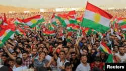 Kurdish people attend a rally to show their support for the upcoming Sept. 25 independence referendum in Duhuk, Iraq, Sept. 16, 2017.