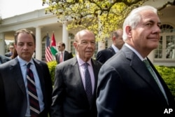 From left, President Donald Trump's Chief of Staff Reince Priebus, Commerce Secretary Wilbur Ross and Secretary of State Rex Tillerson at the White House in Washington, April 5, 2017.