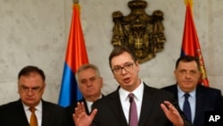 Serbia's Prime Minister Aleksandar Vucic, front, speaks during a press conference in Belgrade, Serbia, Feb. 22, 2017.
