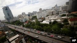 FILE - Cars cross the Thai-Japanese friendship bridge in Bangkok, Thailand.