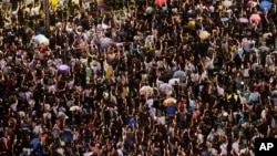 Tens of thousands of people attended the 2013 gathering in Hong Kong to mark the 24th anniversary of the Tiananmen Square crackdown in Beijing, China. (AP Photo/Kin Cheung)