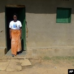 Jaqueline Mukamana, a genocide survivor, stands outside her home