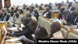 South Sudanese lawmakers listen as Finance Minister Aggrey Sabuni Tisa presents the 2014-15 budget.