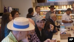 Steven Margolis (center) at at Zabar's delicatessen in New York