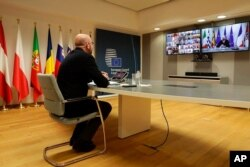 The President of the European Council Charles Michel participates in a video conference of world leaders from the Group of 20 and other international bodies and organizations, from Brussels, Belgium, March 26, 2020.
