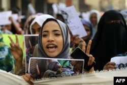 FILE - Sudanese from various women's groups take part in a march through the streets of the capital Khartoum to call for the best outcome for women in the period of political transition, May 30, 2019.