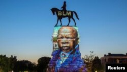 The image of late Rep. John Lewis, a pioneer of the civil rights movement and long-time member of the U.S. House of Representatives, is projected on the statue of Confederate General Robert E. Lee in Richmond, Virginia, July 19, 2020.