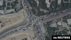 Traffic jam and crowds are seen near Kabul's airport in Afghanistan, Aug. 16, 2021.