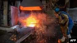 An employee works at a metal production plant in Huangshi in China's central Hubei province, April 1, 2020.