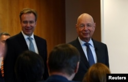 Klaus Schwab, founder and Executive Chairman of the World Economic Forum (WEF), and WEF President Borge Brende arrive for a news conference ahead of the Davos annual meeting in Cologny near Geneva, Switzerland, January 14, 2020. REUTERS/Denis…