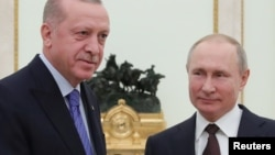 Russian President Vladimir Putin and Turkish President Tayyip Erdogan pose for a photo during a meeting in Moscow, Russia March 5, 2020. Sputnik/Mikhail Klimentyev/Kremlin via REUTERS ATTENTION EDITORS - THIS IMAGE WAS PROVIDED BY A THIRD PARTY.