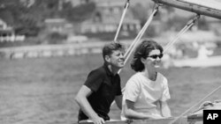 Democratic presidential nominee Sen. John F. Kennedy and wife Jacqueline in cockpit of their sailboat, Victura at Hyannis Port, Mass., Aug. 7, 1960.