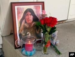 FILE - This Aug. 28, 2017 file photo shows a memorial to Savanna LaFontaine-Greywind outside the apartment where Greywind lived with her parents in Fargo. N.D. Her murder shocked the nation and helped give impetus to the MMIW movement.