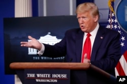 FILE - President Donald Trump speaks about the coronavirus in the James Brady Press Briefing Room of the White House, April 8, 2020.