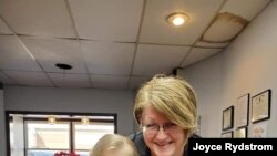 Alta, Iowa, hairstylist Joyce Rydstrom, shown in her salon with her granddaughter, says her emergency fund is shrinking while her salon remains closed because of the coronavirus pandemic.