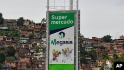 Sign for the first Iranian supermarket that is set to open its doors in Latin America stands near a poor neighborhood in Caracas, Venezuela, July 29, 2020.