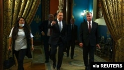 Russian Foreign Minister Sergei Lavrov and U.S. Deputy Secretary of State Stephen Biegun walk during their meeting in Moscow, Russia, Aug. 25, 2020. (Russian Foreign Ministry/Handout via Reuters)