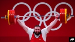 Lasha Talakhadze of Georgia competes in the men's +109kg weightlifting event, at the 2020 Summer Olympics in Tokyo, Japan, Aug. 4, 2021.