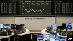 FILE - The curve of the German stock index DAX is seen at the stock market in Frankfurt, Germany, March 17, 2020.