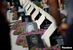 FILE - Graves are seen at the memorial cemetery for Georgian soldiers killed during the war with Russia over the breakaway region of South Ossetia in 2008 in Tbilisi, Georgia, Aug. 8, 2017.