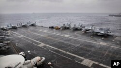 F18 aircrafts are parked on U.S. Navy aircraft carrier USS NIMITZ