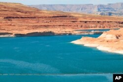 FILE - This Aug. 21, 2019, image shows Lake Powell near Page, Ariz.