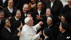 FILE - Pope Francis greets a group of nuns during his weekly general audience, in Paul VI Hall at the Vatican, Jan. 15, 2020.