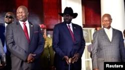 From left, South Sudan opposition leader Riek Machar, South Sudan's President Salva Kiir and Uganda's President Yoweri Museveni pose for a photo at the State House in Entebbe, Uganda, Nov. 7, 2019.