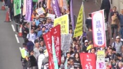 数以千计港人游行反对威权声援政治犯