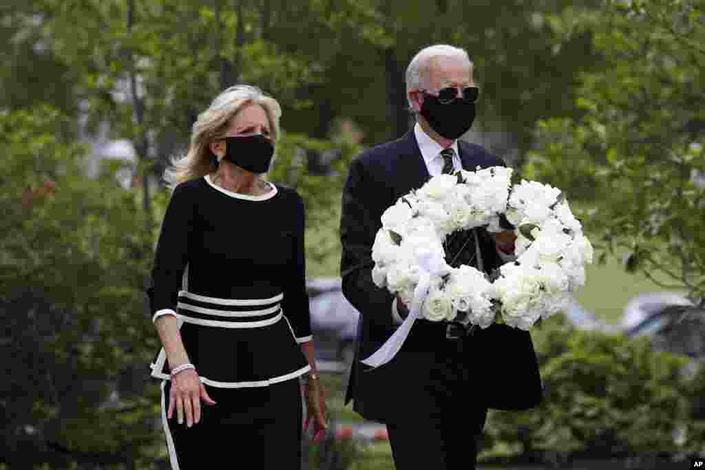 Democratic presidential candidate, former Vice President Joe Biden, and his wife Jill Biden arrive to place a wreath at the Delaware Memorial Bridge Veterans Memorial Park, in New Castle, Delaware.