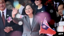 FILE - Taiwan President Tsai Ing-Wen waves during National Day celebrations in front of the Presidential Palace, in Taipei, Taiwan, Oct. 10, 2019.