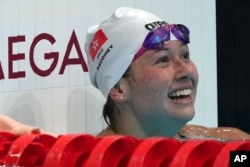 Siobhan Bernadette Haughey of Hong Kong smiles after the women's 200-meter freestyle final at the 2020 Summer Olympics, July 28, 2021, in Tokyo, Japan.