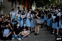 Schoolmates and protesters gather in support of student Tsang Chi-kin, 18, who was shot in the chest by police during violent pro-democracy protests that coincided with China's Oct. 1 National Day. The student is in stable condition.