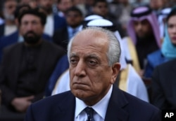 FILE - Washington peace envoy Zalmay Khalilzad attends the inauguration ceremony for Afghan President Ashraf Ghani at the presidential palace in Kabul, Afghanistan, March 9, 2020.