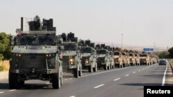 A Turkish miltary convoy is pictured in Kilis near the Turkish-Syrian border, Turkey, Oct. 9, 2019.