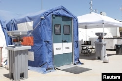 FILE - Medical facilities are seen at the Tornillo facility, a shelter for children of detained migrants, in Tornillo, Texas, in this undated handout photo provided by the US Department of Health and Human Services.
