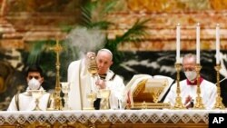 Pope Francis celebrates the Easter vigil in a nearly empty St. Peter's Basilica as coronavirus pandemic restrictions stay in place for a second year running, at the Vatican, April 3, 2021.