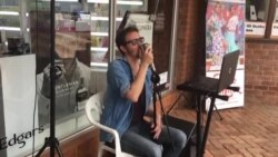 Musician Alex Entertains People at Sam Levy's Village