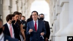 Treasury Secretary Steven Mnuchin, center, leaves following a meeting with House Speaker Nancy Pelosi of Calif. and Senate Minority Leader Sen. Chuck Schumer of N.Y. as they continue to negotiate a relief package on Capitol Hill, Aug. 7, 2020.