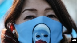 A protester from the Uyghur community living in Turkey, participates in a protest in Istanbul, Thursday, March 25, against against the visit of China's FM Wang Yi to Turkey. Hundreds of Uyghurs staged protests in Istanbul and the capital Ankara,…