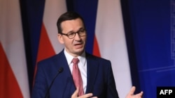 FILE - Poland's Prime Minister Mateusz Morawiecki speaks during a press conference in Vilnius, Lithuania, Sept. 17, 2020.