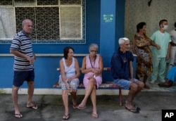 Elderly residents wait for a dose of the Pfizer COVID-19 vaccine, during a booster shot campaign for the elderly in long-term care institutions, at Casa de Repouso Laco de Ouro nursing home, in Rio de Janeiro, Brazil, Sept. 2, 2021.
