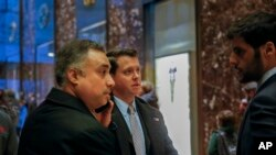 In this Dec. 12, 2016 photo, Los Angeles venture capitalist Imaad Zuberi, far left, arrives at Trump Tower in New York. Zuberi agreed this month to plead guilty to making illegal campaign contributions on behalf of foreign nationals and concealing…
