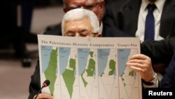 Palestinian President Mahmoud Abbas holds a document while speaking during a Security Council meeting at the United Nations in New York, Feb. 11, 2020.