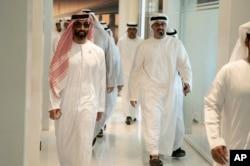In this Feb. 6, 2019 photo, released by Emirates News Agency, Sheikh Tahnoun bin Zayed Al Nahyan, left, walks to a meeting in Abu Dhabi, UAE.