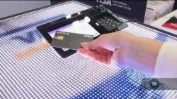 Платити відбитком пальця пропонує компанія «Віза». Відео