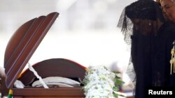 FILE: Former first lady of Zimbabwe, Grace Mugabe pays her last respects during a state funeral of her husband and Zimbabwe's longtime ruler Robert Mugabe, at the national sports stadium in Harare, Sept. 14, 2019.